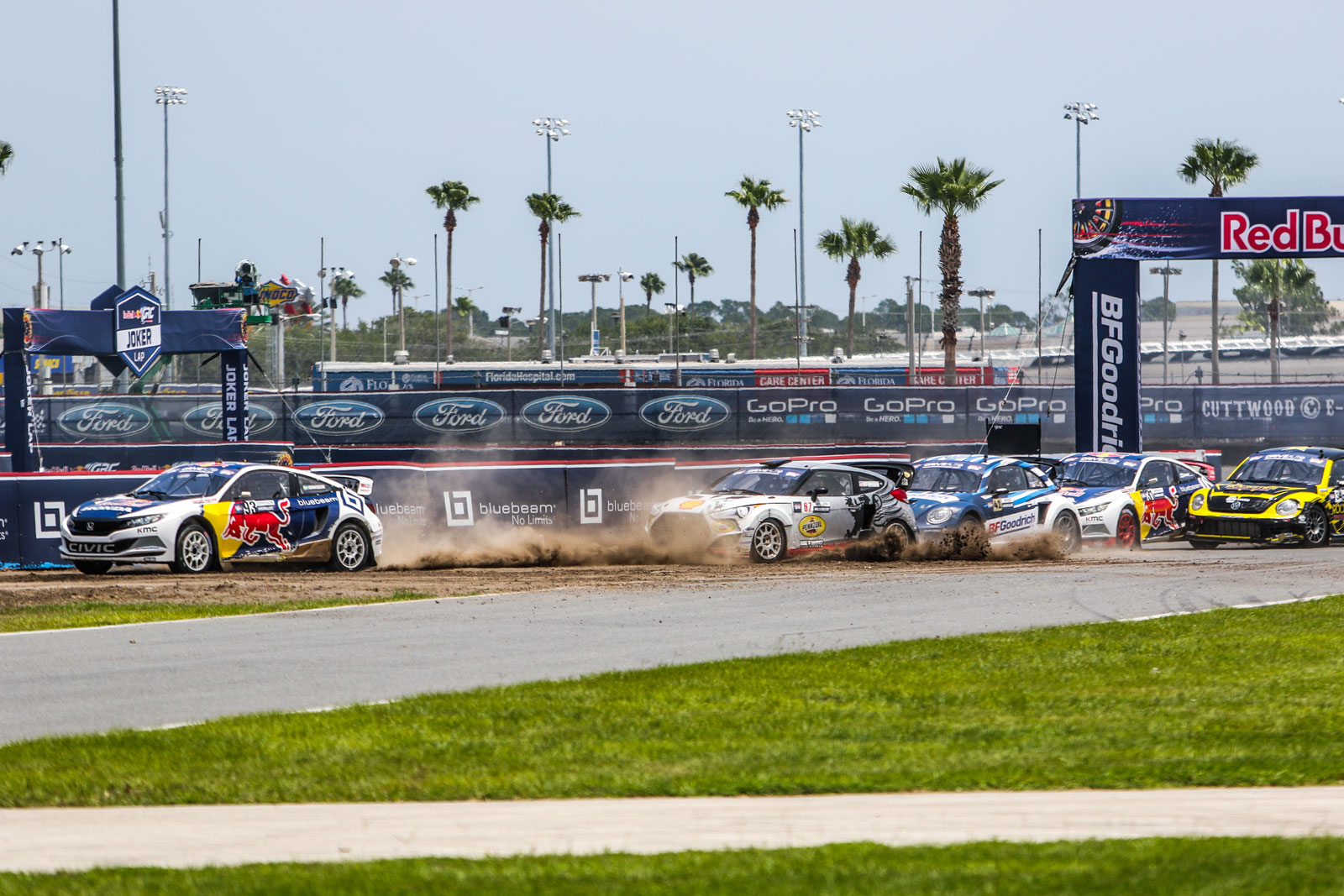 Cars tearing up the Red Bull Global Rallycross track at Daytona International Speedway with the Red Bull Bluebeam Honda Civic leading the pack.
